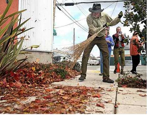 Ken Foster of Terra Nova Landscaping demonstrates an alternative to leaf blowers. Photo by Dan Coryo, Santa Cruz Sentinel